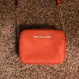 Michael Kors crossbody bag in orange and gold